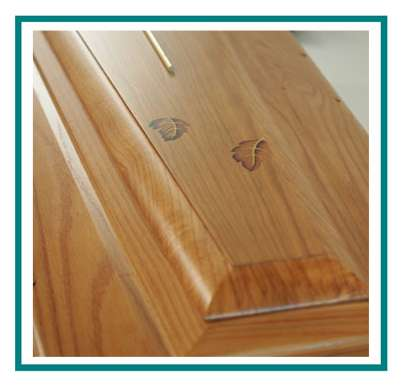 rotastyle casket manufacturer leaves in the wind American oak detail1